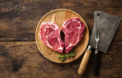 Heart shape raw fresh veal meat steaks Royalty Free Stock Images