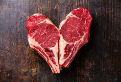 Heart shape Raw meat steak on bone Royalty Free Stock Images