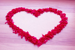 Heart shape of red confetti  - white copy space and pink background Royalty Free Stock Photo
