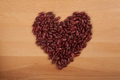 Heart shape of red kidney beans Stock Photos