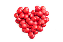 Heart shape with red milk chocolate candies on white background Stock Images
