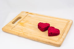 Heart shape Red Velvet cake on wooden plate Stock Images