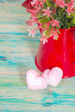 Heart shape with red watering can.Still life Royalty Free Stock Photo