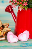 Heart shape with red watering can.Still life Stock Image