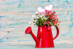 Heart shape with red watering can.Still life. Of love Royalty Free Stock Photography