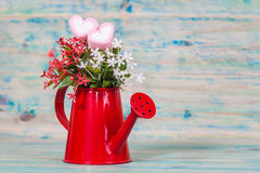 Heart shape with red watering can.Still life. Of love Royalty Free Stock Photo