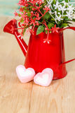 Heart shape with red watering can.Still life. Of love Stock Image
