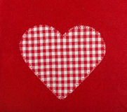 Heart shape on red wool background. Royalty Free Stock Photography