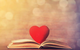 Heart shape and retro book. Royalty Free Stock Photos