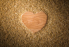 Heart shape rice on paddy Royalty Free Stock Photos