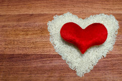 Heart shape of rice with red heart on valentine's day, Jasmine rice. Heart shape of rice with red heart on valentine's day, Jasmine rice in wooden spoon on stock images