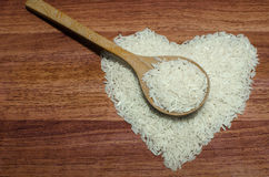 Heart shape of rice on valentine's day, Jasmine rice with wooden spoon. Heart shape of rice on valentine's day, Jasmine rice with wooden spoon on wooden table ( Stock Photography