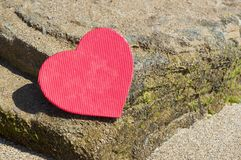 Heart shape on a rocky beach. Summer love abstract. Heart shape placed  on a rocky beach. Summer love abstract Royalty Free Stock Image