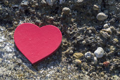 Heart shape on a rocky beach. Summer love abstract Stock Photo