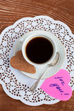Heart shape Saint Valentine's Cookie with cup of coffee Royalty Free Stock Image