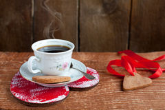 Heart shape Saint Valentine's Cookie and cup of coffee with stea Royalty Free Stock Image