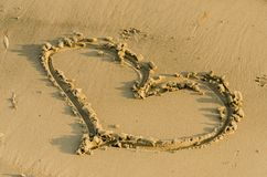 Heart shape in sand Stock Images