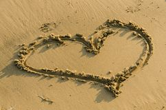 Heart shape in sand Stock Photos