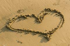 Heart shape in sand Stock Photos