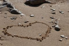 Heart shape in the sand royalty free stock images