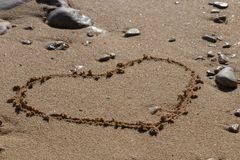 Heart shape in the sand royalty free stock image