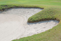 Heart shape sand bunker on beautiful green golf course. Royalty Free Stock Images
