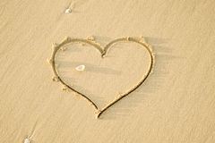 Heart shape in sand Royalty Free Stock Images