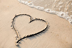 Heart shape sand painting Stock Photos