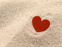 Heart shape on sand Stock Image