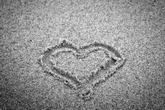 Heart shape on sand. Romantic, black and white Stock Photography