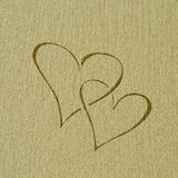 Heart shape on the sand surface Royalty Free Stock Images