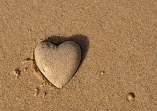Heart shape of the sand - a symbol of love Stock Photography