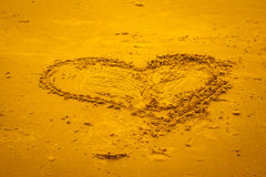 Heart shape in the sand. Stock Image