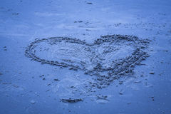 Heart shape in the sand. Stock Images