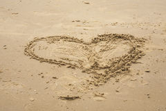 Heart shape in the sand. Stock Photo