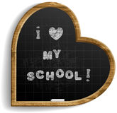 Heart Shape School Blackboard with expression I love my school . Realistic image. Handmade font was used. Smartly grouped and layered Royalty Free Stock Photos