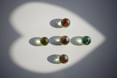 Heart shape, shining Glass marbles and shadow royalty free stock images