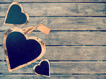 Heart shape sign on wooden wall. Vintage love concept background, with copy space Royalty Free Stock Photos