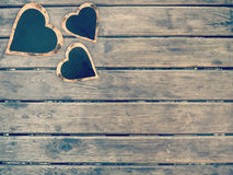 Heart shape sign on wooden wall. Vintage love concept background, with copy space Royalty Free Stock Photo