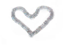 Heart shape of silvery Christmas tinsel Stock Images