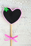 The heart shape small black board or chalkboard over old white w Royalty Free Stock Photos