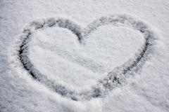 Heart shape in snow Royalty Free Stock Photo