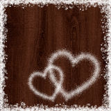 Heart shape from snow on dark wood background. Heart shape from snow on maroon wood background Royalty Free Stock Images