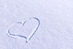 Heart shape in snow Stock Images