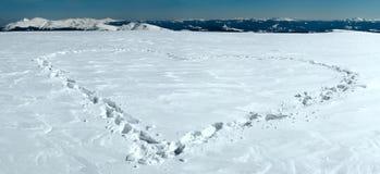 Heart shape on snow Royalty Free Stock Photo