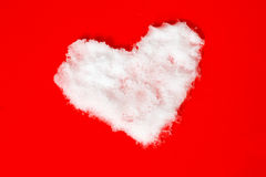 Heart shape of snow on red Royalty Free Stock Image