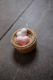 Heart shape soaps with word 'Love' on wooden background Royalty Free Stock Photos