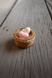 Heart shape soaps with word 'Love' on wooden background Royalty Free Stock Images