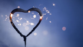 Heart shape sparkler. Burning and glowing in the dark Royalty Free Stock Photography