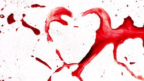 Heart shape from splashes and blobs. Abstract red heart shape from splashes and blobs and drops stock footage